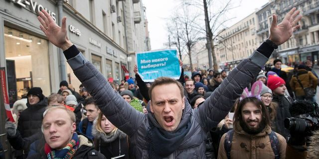 Russian opposition leader Alexei Navalny shares picture from hospital bed after suspected poisoning