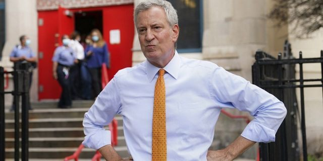 In this Aug. 19, 2020, file photo, de Blasio speaks to reporters after visiting New Bridges Elementary School in the Brooklyn borough of New York. (AP Photo/John Minchillo, File)