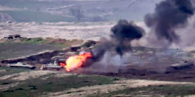 In this image taken from a footage released by Armenian Defense Ministry on Sunday, Sept. 27, 2020, Armenian forces destroy Azerbaijani military vehicle at the contact line of the self-proclaimed Republic of Nagorno-Karabakh, Azerbaijan.