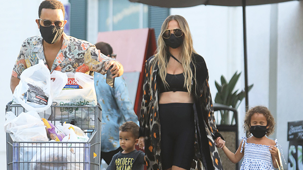 Chrissy Teigen Rocks A Crop Top While Pregnant & Holds Hands With Adorable Kids At Grocery Store