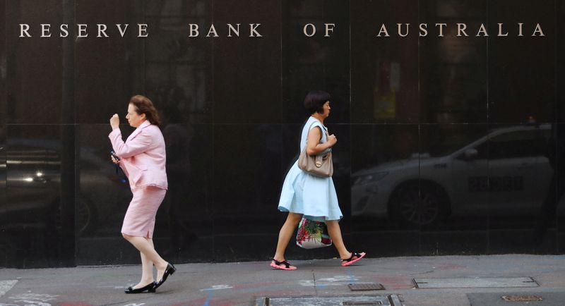 Australia central bank holds rates, but signals more easing soon
