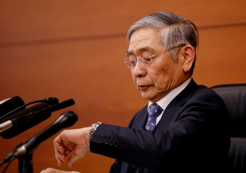 BOJ's Kuroda says economy likely to follow improving trend
