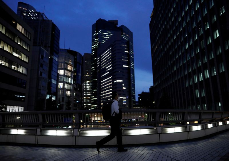 Japan raises view on demand, but says economy in severe situation