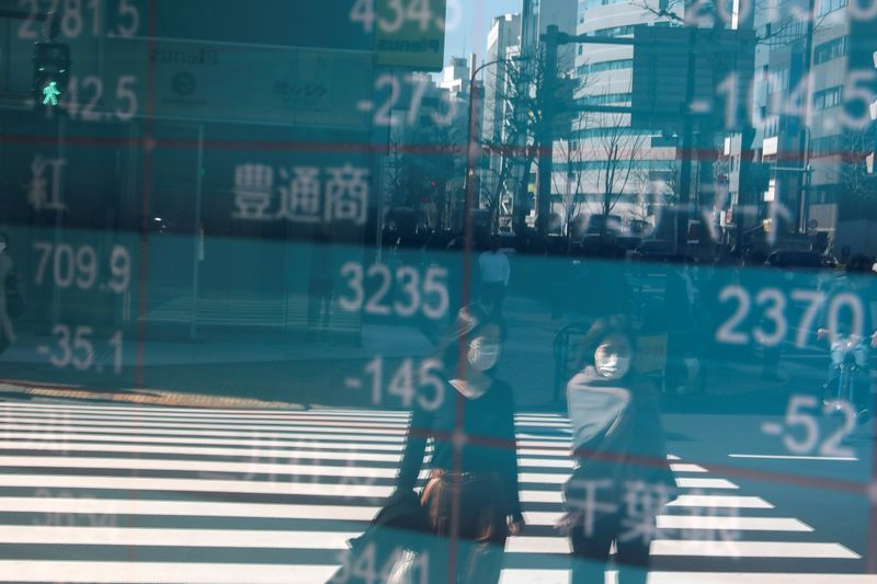 Asian shares look for rebound following tech earnings