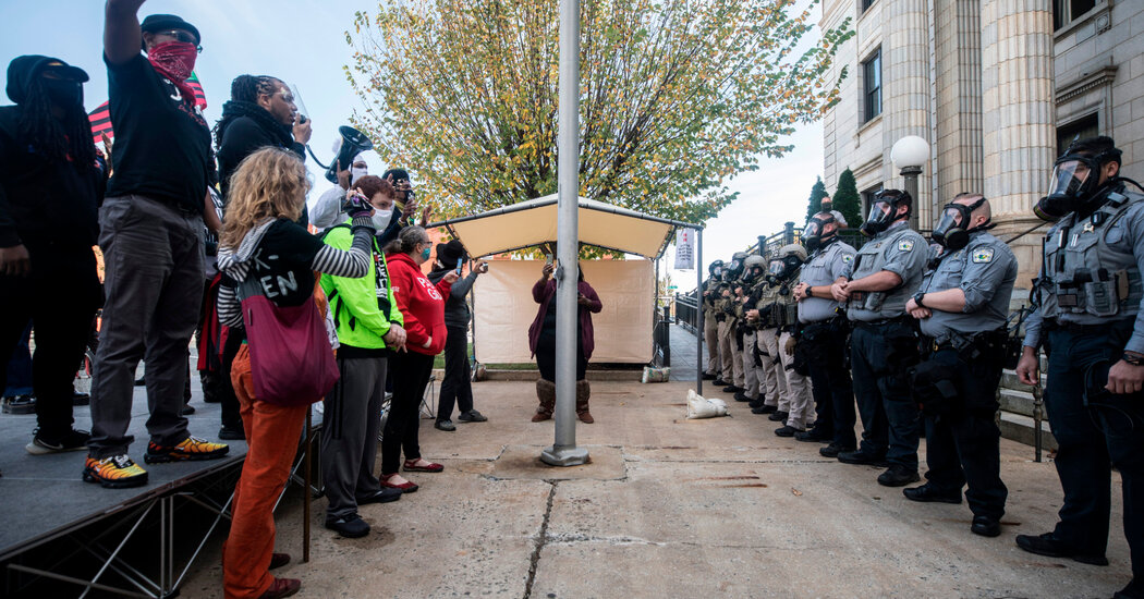 Police in North Carolina use a chemical spray to disperse a get-out-the-vote rally.