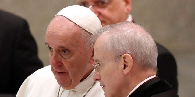 """A Vatican official who is a key member of Francis' COVID-19 response commission, the Rev. Augusto Zampini, acknowledged Tuesday that at age 83 and with part of his lung removed after an illness in his youth, Francis would be at high risk for complications if he were to become infected. Zampini said he hoped Francis would don a mask at least when he greeted people during the general audience. """"We are working on that,"""" he said. (AP Photo/Alessandra Tarantino)"""