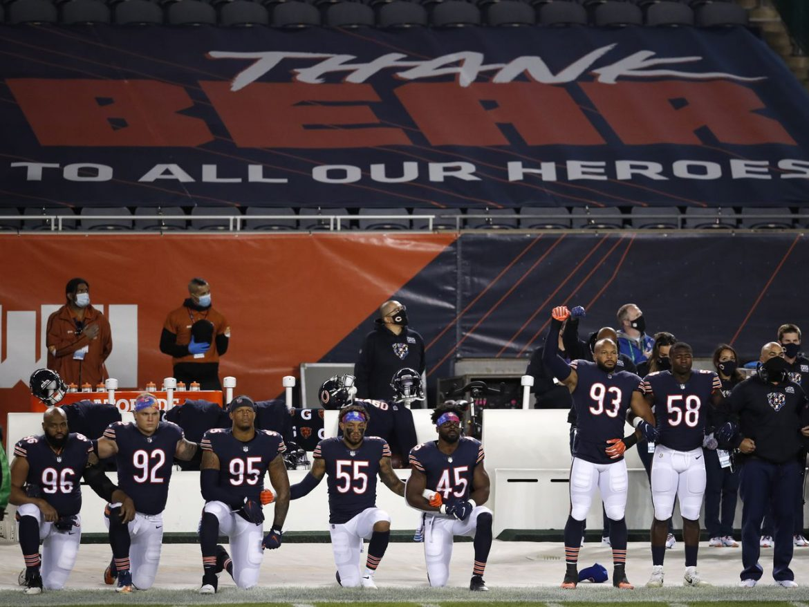 Bears players protest racial injustice during national anthem at Panthers game