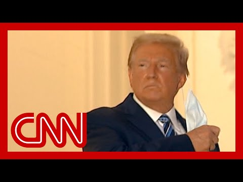 Contagious President Trump removes mask at White House