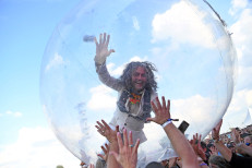 The Flaming Lips perform for audience inside plastic bubbles