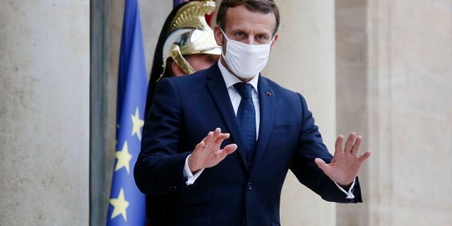 French President Emmanuel Macron was expected to announce new restrictions during a planned televised evening address to the nation later Wednesday. (AP Photo/Thibault Camus)