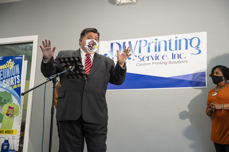 Gov. J.B. Pritzker answers questions at news conference in the South Austin neighborhood earlier this month.