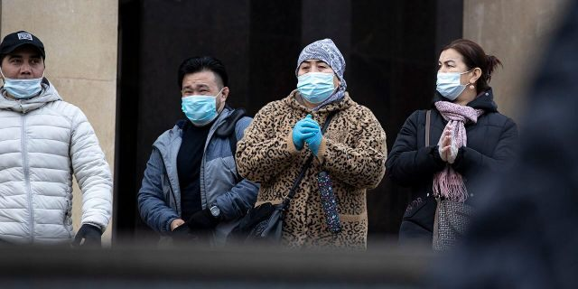 People wearing face masks to help curb the spread of the coronavirus leave a subway in Moscow, Russia, on Monday. Despite the sharp spike in daily new infections, Russian authorities have repeatedly dismissed the idea of imposing a second lockdown or shutting down businesses after most virus-related restrictions were lifted during the summer. (AP Photo/Alexander Zemlianichenko)