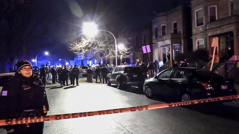 The scene after a mass shooting last Dec. 22 in the 5700 block of South May Street in which 13 people were shot and wounded.