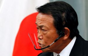 Japan's Aso asks banks to help as firms' funding needs rise at year-end