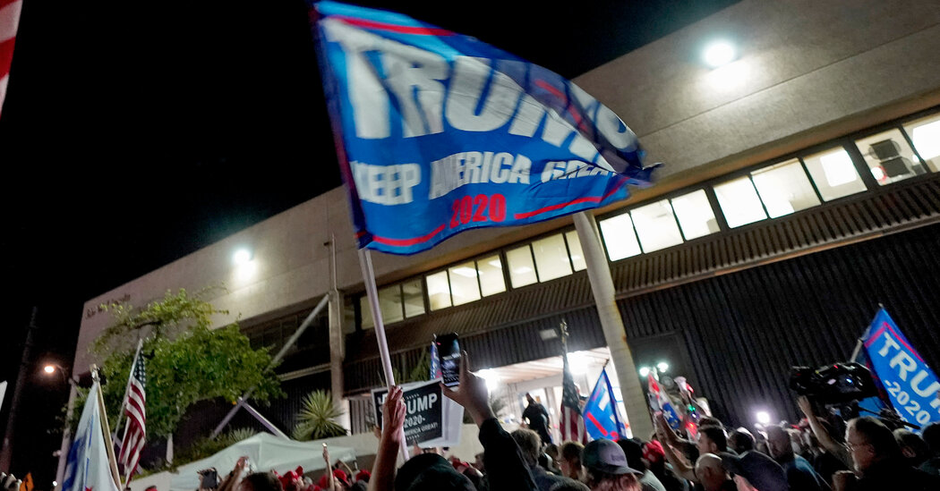 With Arizona too close to call, Trump supporters gather at a vote-counting site in Phoenix.