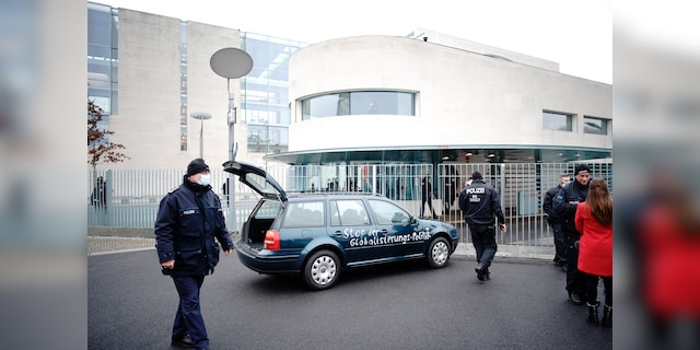 Berlin police: Car with with slogan on side hits chancellery gate