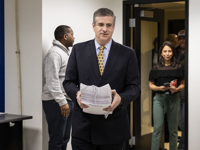 Cook County Board Of Review Commissioner Dan Patlak files his reelection nominating petitions to get his name on the March primary ballot last November.