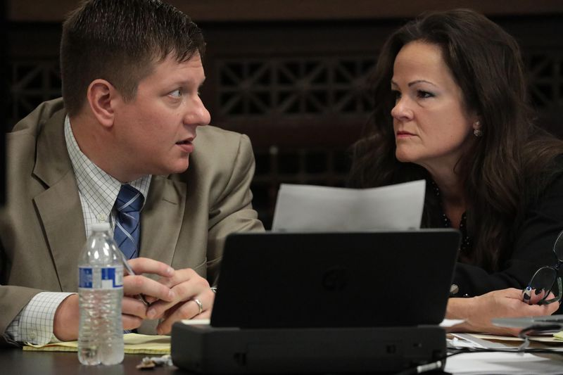 Former Chicago Police Officer Jason Van Dyke talks with his attorney Tammy Wendt during the sixth day of Van Dyke's trial for the shooting death of Laquan McDonald in 2018.