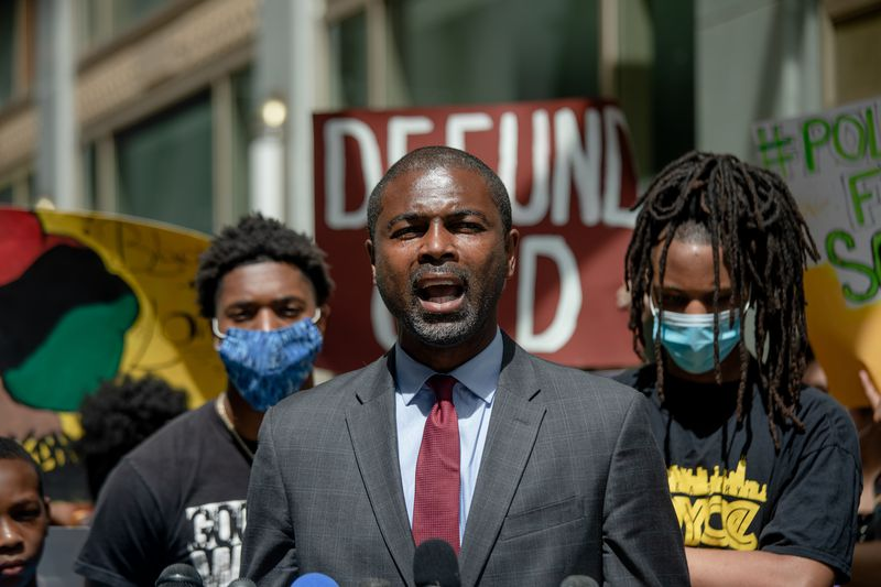 State Rep. La Shawn Ford joins a protest in the loop in June.