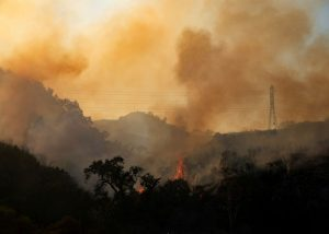 Firefighters move in on Southern California canyon blaze despite high winds