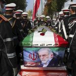 Iran faces world pressure, promises to avenge nuclear scientist's death