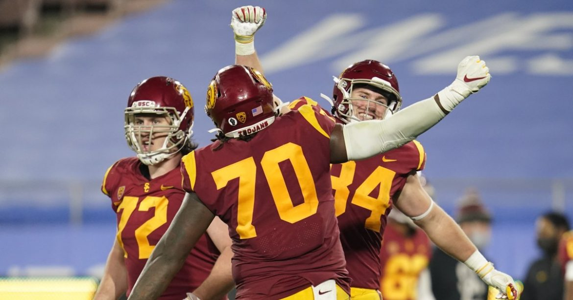 Plaschke: USC shows its comeback moxie by fighting on and on in rivalry triumph