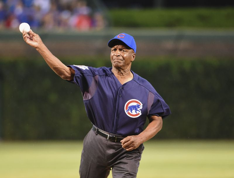 Illinois Secretary of State Jesse White throws out a ceremonial first pitch in 2016.