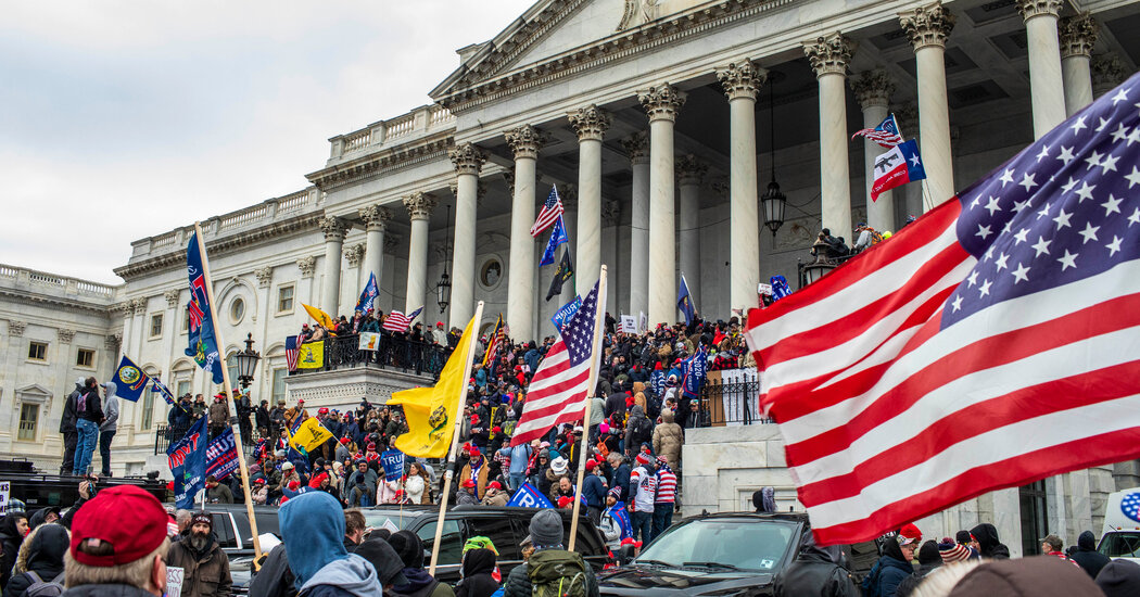 For Immigrants Watching a Mob Storm the Capitol, a Sense of Shock and Shame