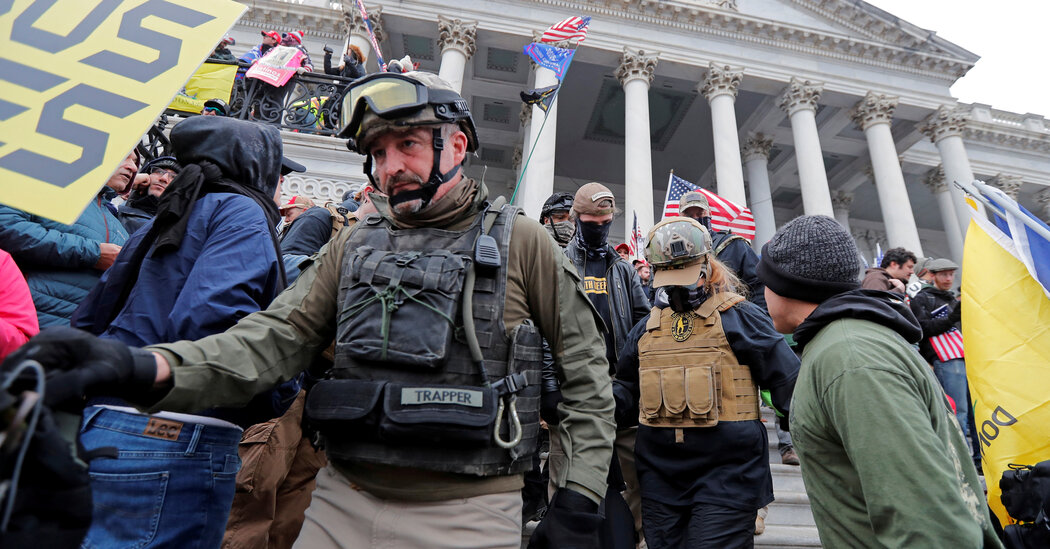 Justice Dept. charges militia members, including military veterans, in Capitol assault.