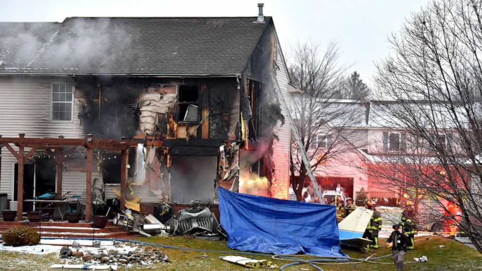 Businessman and family die when plane hits Michigan house
