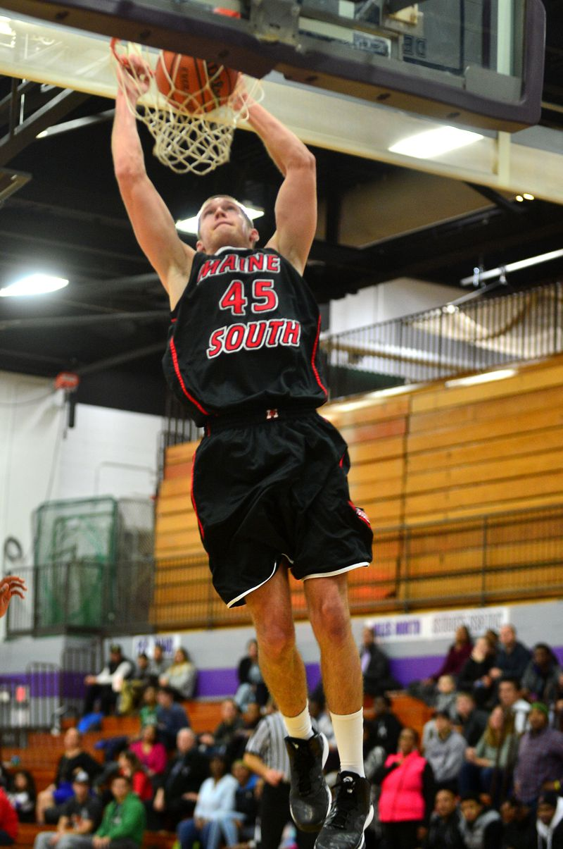Maine South's George Sargeant dunks against Niles North.