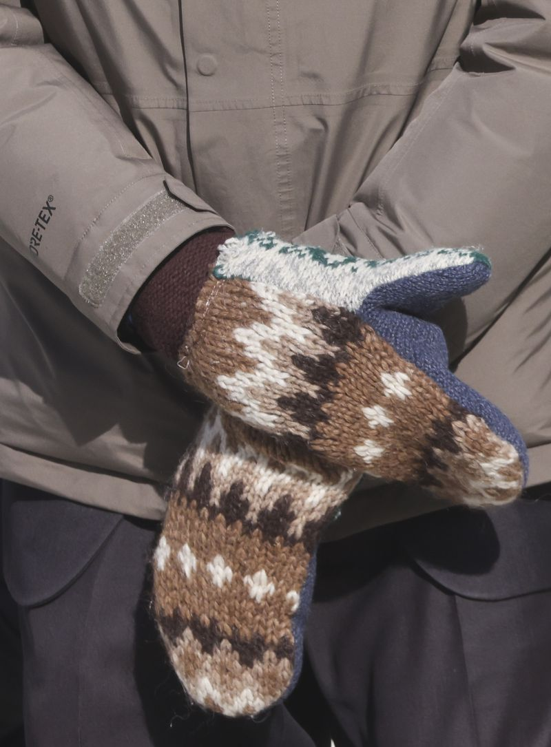 A close up of Senator Bernie Sanders' mittens are shown as he attends President-elect Joe Biden's inauguration ceremony,