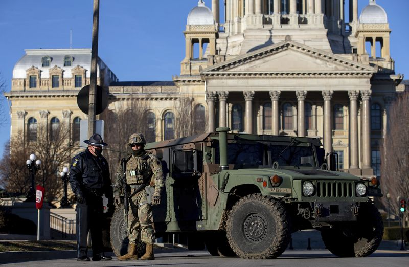 Members of the Illinois National Guard and the Capitol Police get setup in front of a road closure at the Illinois State Capitol on Wednesday.
