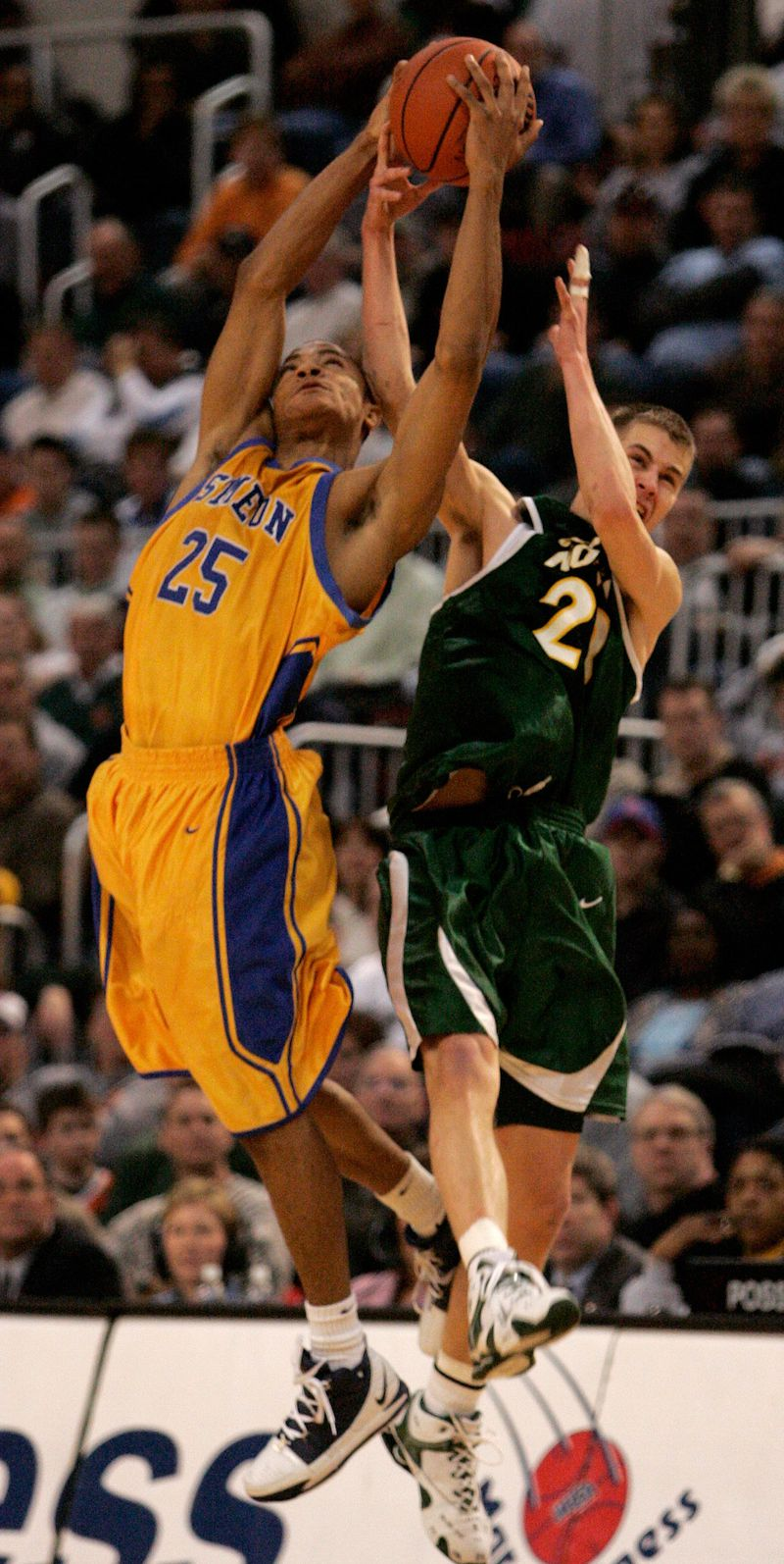 Glenbrook North's Jonathan Scheyer, right, and Simeon's Derrick Rose (25) go for the ball during the fourth quarter of the quarterfinals of the IHSA boys' Class AA state basketball tournament in Peoria, Ill., Friday, March 17, 2006.
