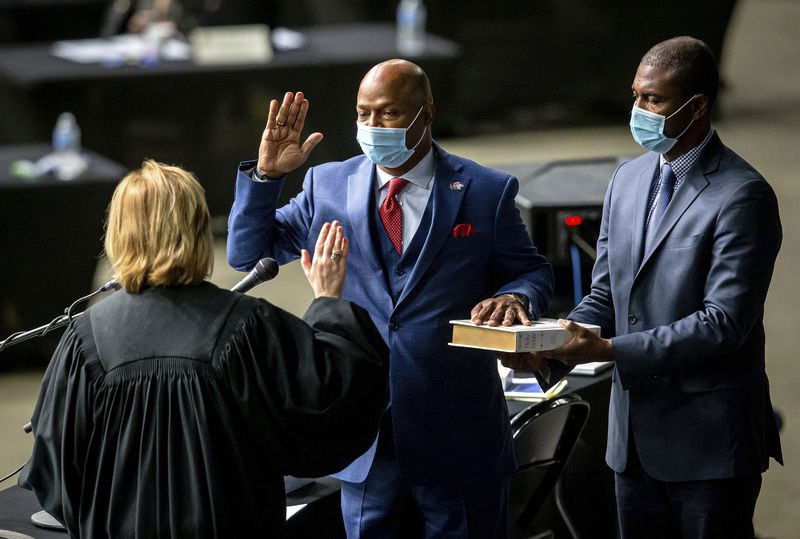 """Newly elected House Speaker Emanuel """"Chris"""" Welch takes the oath of office at the Illinois House of Representatives at the Bank of Springfield Center earlier this month."""