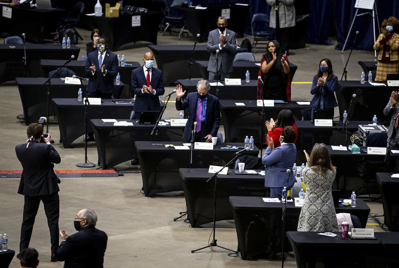 Outgoing House Speaker Michael Madigan, D-Chicago, gets a standing ovation on Wednesday.
