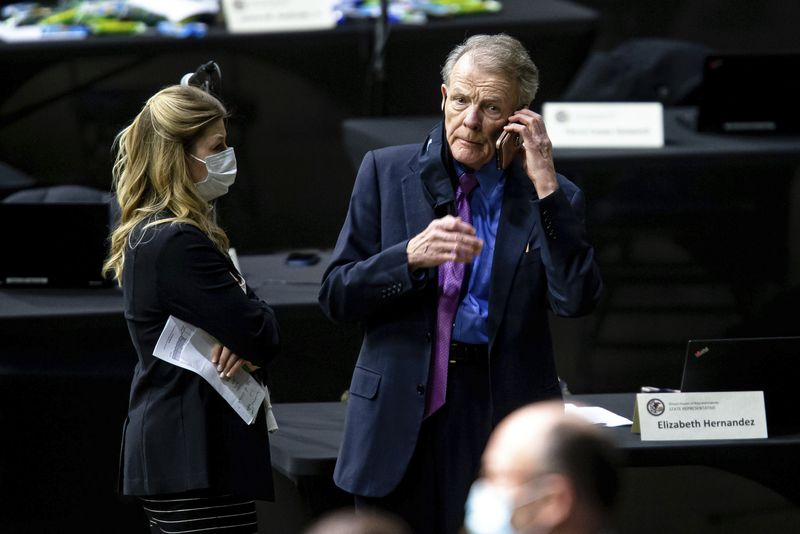 Outgoing House Speaker Michael Madigan, D-Chicago, takes a phone call at the Bank of Springfield Center on Wednesday.