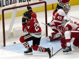 Pius Suter's historic hat trick powers Blackhawks' rout of Red Wings