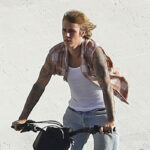 Justin Bieber Shows Off Muscles & Tattoos In Sleeveless Top As He Rides A Motorcycle For New Video Shoot