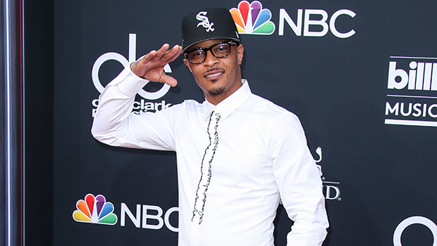 T.I. Cradles Newborn Granddaughter In Sweet New Pic & Says He's 'Completely In Love'