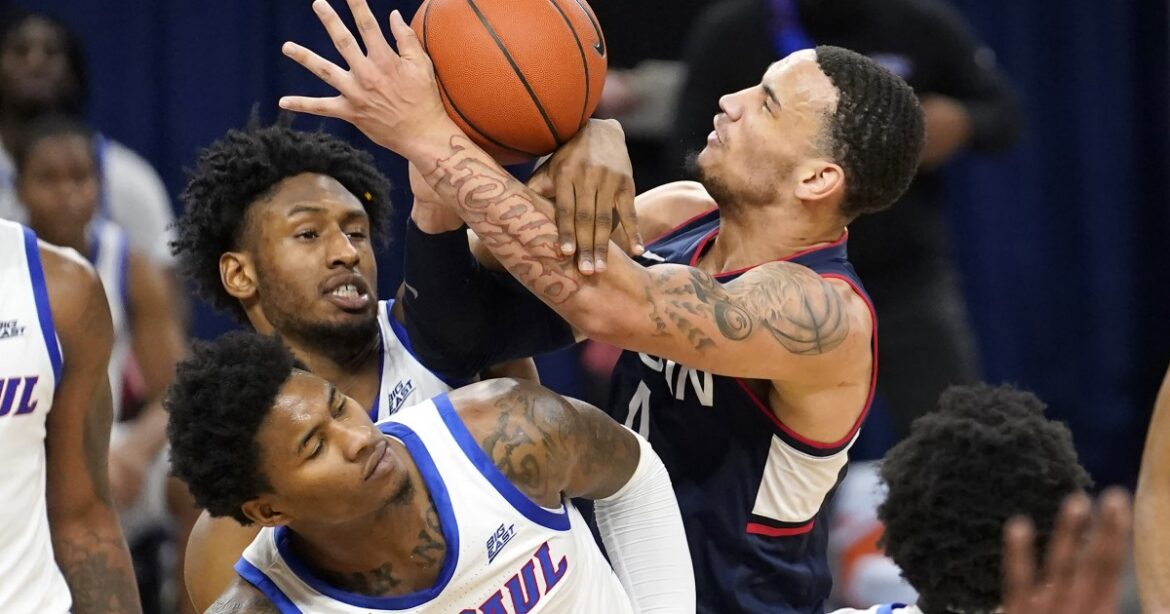 College basketball: No. 25 UConn squeezes past DePaul