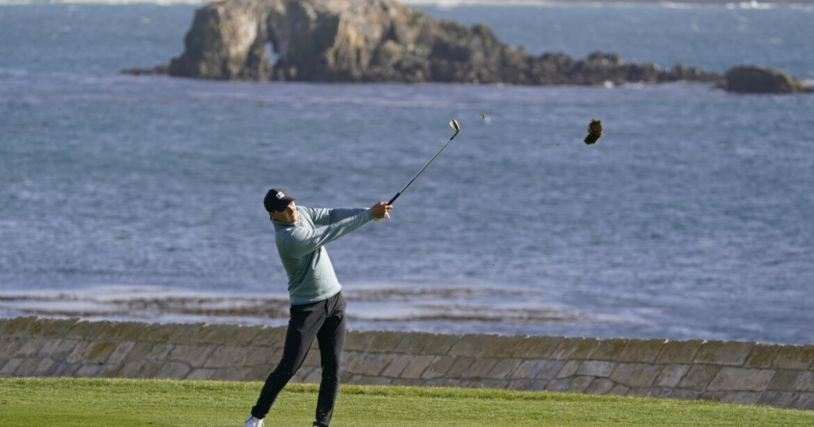 Late eagle from the fairway stakes Jordan Spieth to lead at Pebble Beach