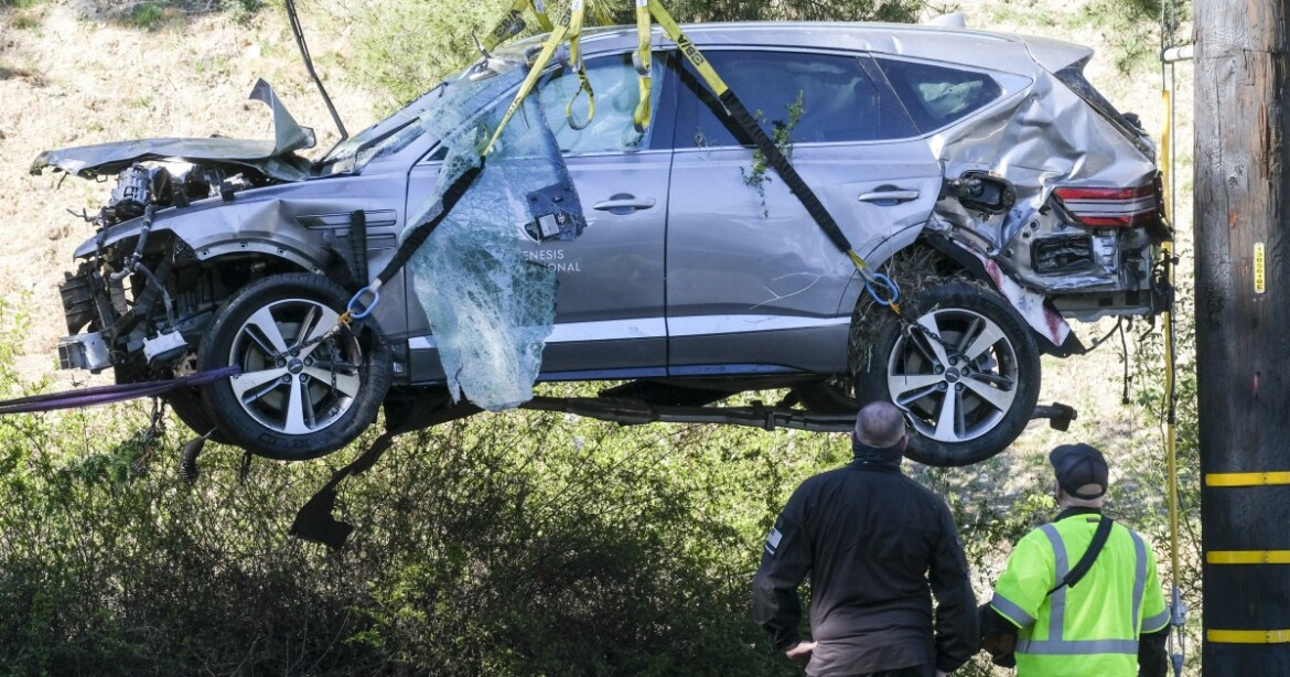 The Sports Report: Tiger Woods breaks both legs in car accident