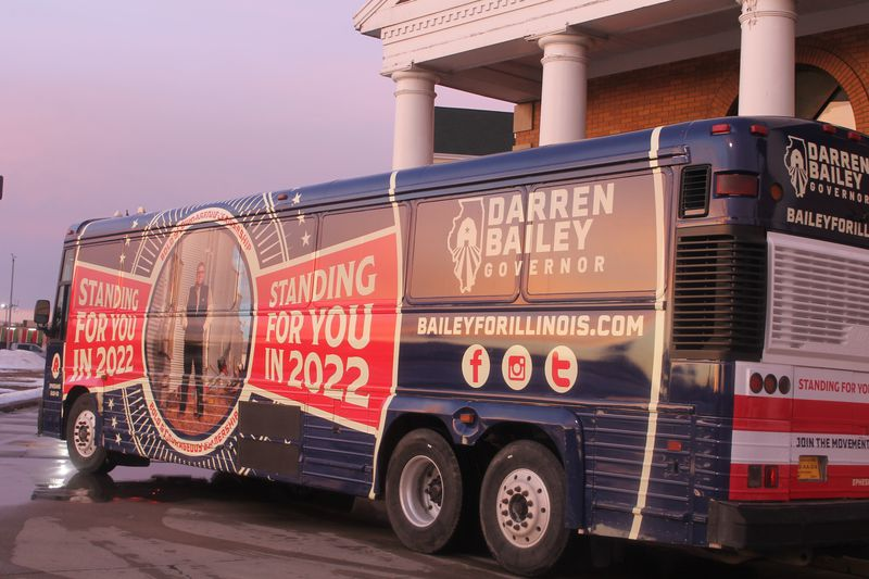 Republican Darren Bailey's campaign bus sits outside the Thelma Keller Convention Center in Effingham on Monday.