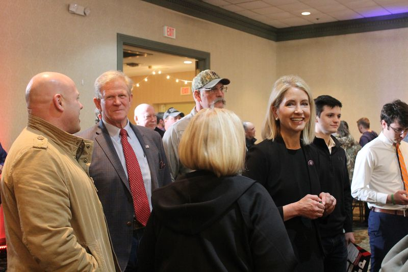 State Rep. Chris Miller, second from left, and his wife, U.S. Rep. Mary Miller; in black, facing camera; at state Sen. Darren Bailey's gubernatorial campaign kick-off in Effingham on Monday.