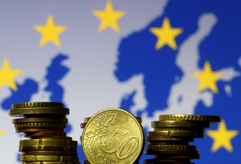 Euro zone in double-dip recession, recovery risks to downside: Reuters poll