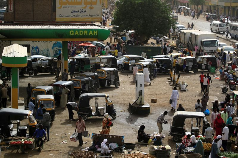 Sudan central bank unifies exchange rate, likely devaluing currency