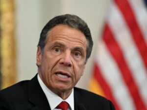 Former aide says Andrew Cuomo kissed her, suggested strip poker