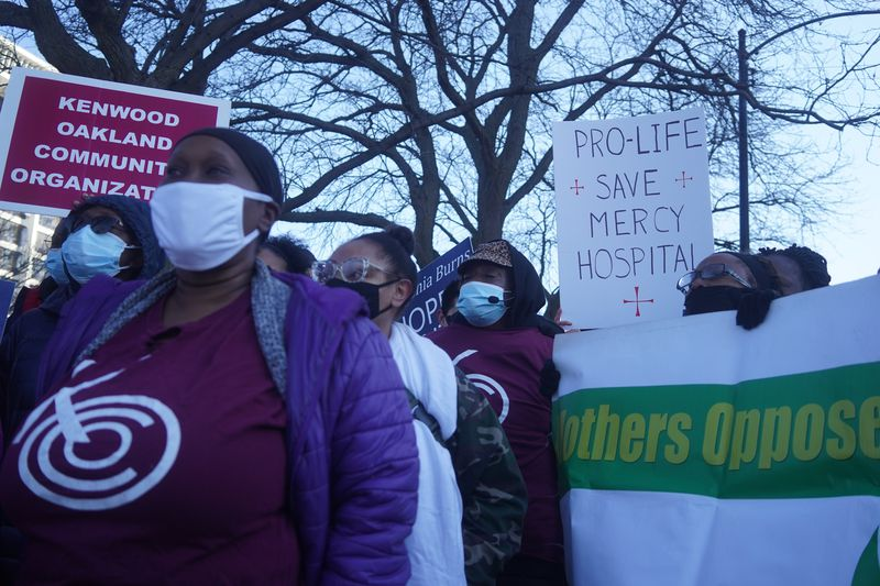Members of the Chicago Health Equity Coalition rally outside of Mercy Hospital on Friday, March 5, 2021.