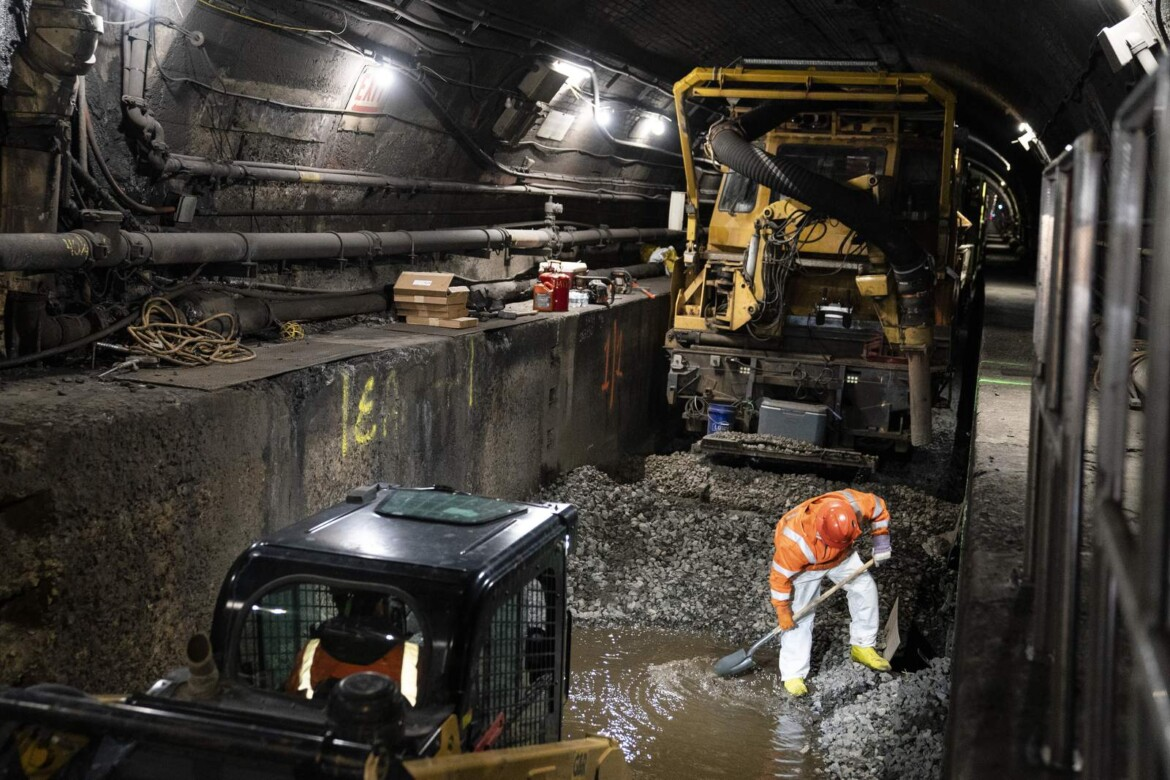 In a leaky underwater rail tunnel, workers race against time